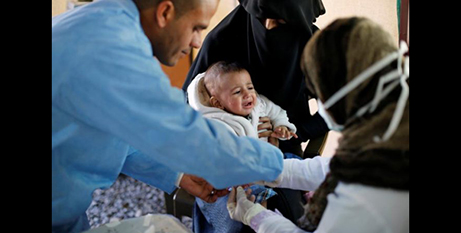 A child is treated for cholera in Sanaa, Yemen, last week (CNS/Khaled Abdullah, Reuters)