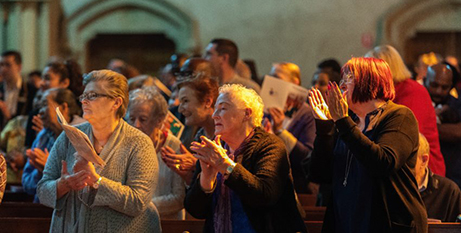 The congregation claps Bishop Charles Gauci at the thanksgiving Mass (The Southern Cross/Ben McMahon)
