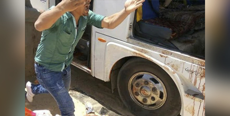 A man screams beside a bus carrying Coptic Christians that was attacked on Friday (Crux/Egypt's Coptic Orthodox Church/AP)