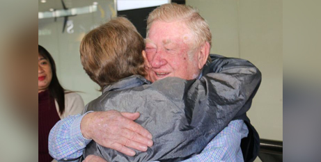 Kevin Fox embraces his sister, Sr Patricia Fox at Melbourne Airport yesterday (ABC News/James Oaten)