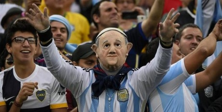 Argentine fans with Pope masks
