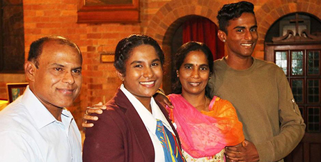 Soumi Gopalakrishnan, second from left, with her family at her graduation Mass in Brisbane (ABC News/Josephine Booth)