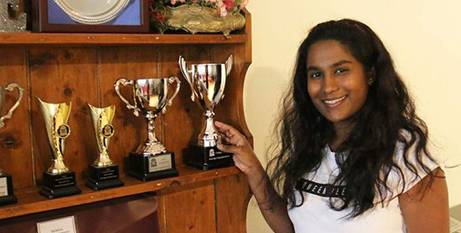 Soumi Gopalakrishnan with academic awards she won at St James College (ABC News/Leonie Mellor)