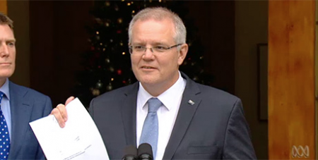 Scott Morrison with the proposed bill yesterday (ABC News)