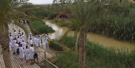 Pilgrims dip in a landmine-free area of the Jordan River (CNS/Debbie Hill)