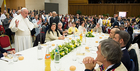 Pope Francis eating with the poor on the World Day of the Poor last month (Vatican Media)