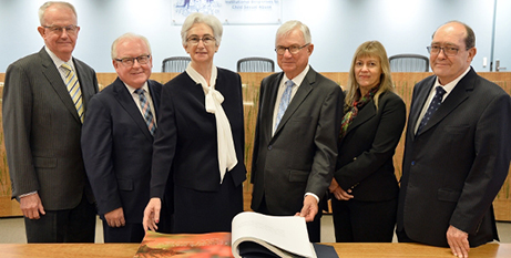 Peter McClellan (third from right) and commissioners with the book