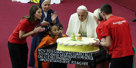 Pope Francis blows out the candles on his birthday cake yesterday (Vatican Media/ANSA)