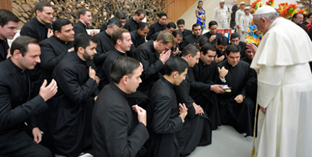Pope Francis blesses seminarians as they make the sign of the cross (CNS)