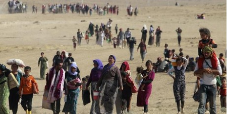 Yazidis fleeing IS