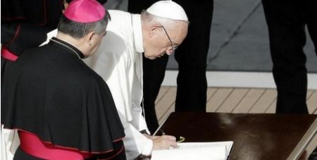 Francis signs the apostolic letters