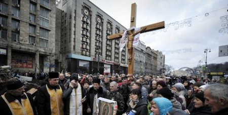 Protesters holding a cross