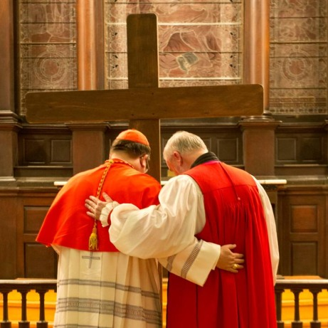 A Catholic and Anglican Bishop pray together