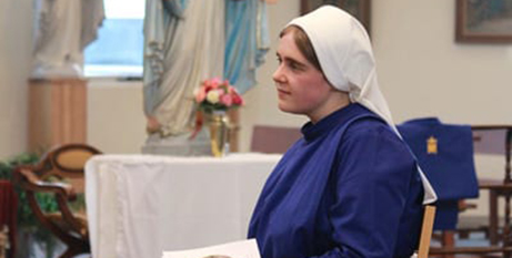 Sr Celine Marie listens to the homily during the Mass for her religious profession (Hobart Catholic/Jess Leach)