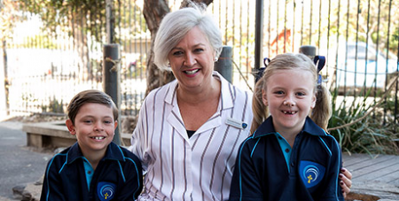 Principal Amanda Parslow and pupils at McAuley Community School (School website)