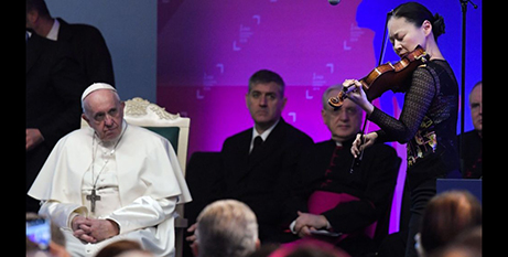 Pope Francis listens to US violinist Midori Goto perform at the Vatican in 2019 (Vatican Media)