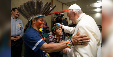 Pope Francis with indigenous people from the Amazonian region during the Synod of Bishops on the Amazon in October 2019 (CNS/Vatican Media)