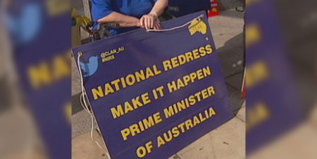 A protestor calling for a national redress scheme in 2016 (ABC News)