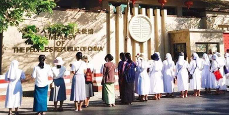Catholic religious pray in front of the Chinese embassy in Yangon on Friday (UCANews/SJA sisters)