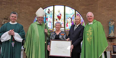 Fr Sean Cullen, Bishop Brian Mascord, Catherine and Jim McGrath and Msgr Francis Marriott with the papal award