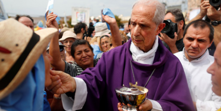 Cardinal Mario Poli distributes Communion during a Mass and pro-life rally outside the Basilica of Our Lady of Lujan in Buenos Aires last Sunday, as survey shows there are now fewer Argentinian Catholics (CNS/Agustin Marcarian, Reuters)