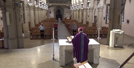 Brisbane Archbishop Mark Coleridge celebrates Mass inside a closed St Stephen's Cathedral in Brisbane yesterday(The Catholic Leader)