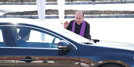 A priest hears drive-through confessions in Huntington, New York on Sunday (CNS/Gregory A Shemitz, Long Island Catholic)