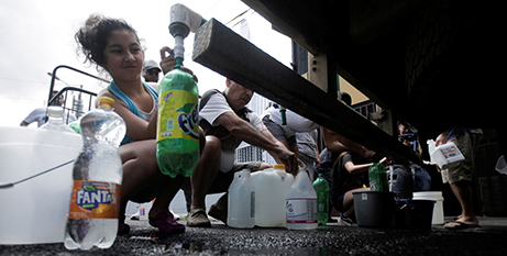 People collect clean drinking water from a tanker sent by government authorities in San Jose, Costa Rica (CNS/Juan Carlos Ulate, Reuters)