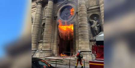 A fire at St Sulpice Church in Paris in 2019 is believed to have been deliberately lit (CNS/Instagram, agneswebste via Reuters)
