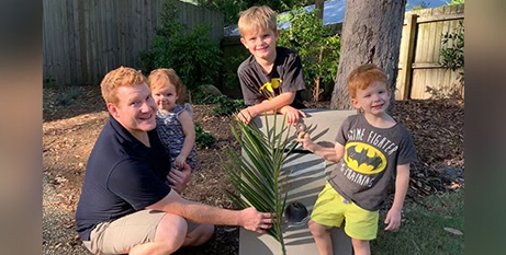 Steven Bird and his chldren put palm branches outside their home for Palm Sunday (The Catholic Leader)