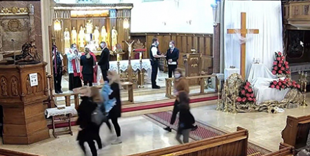 Police stand on the altar at Christ the King Polish church in London after ordering the congregation to leave the Good Friday service due to COVID-19 restrictions (CNS/YouTube)