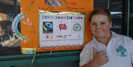 A St Thomas More primary school student gives the Ethical Easter Egg Raffle the thumbs up (ACRATH)