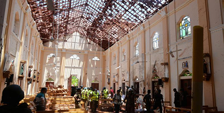 Police investigate after the bombing at St Sebastian Church in Negombo, Sri Lanka, on April 21, 2019 (CNS/Reuters)