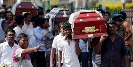 Coffins of victims are carried during a mass burial for victims in Colomb, Sri Lanka on Tuesday (CNS/Dinuka Liyanawatte, Reuters)