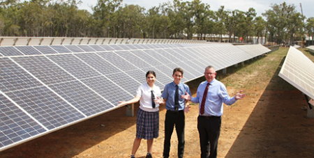 Shalom College captains Brigette McMahon and Oliver Collins with principal Dan McMahon showcase their solar farm (The Catholic Leader)