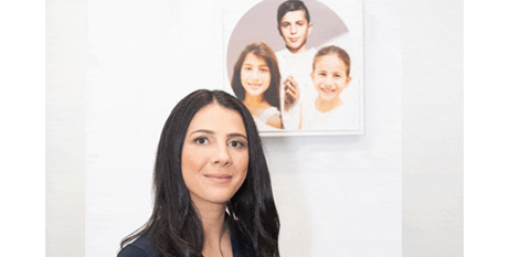 Leila Abdallah with a portrait of Antony, Angelina and Sienna (The Catholic Weekly/Giovanni Portelli)