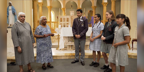 Sr Veronica Willaway OSB and Donella Brown with the message stick they will give to student leaders (Catholic Mission)