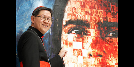 Cardinal Luis Tagle points to the picture of his maternal grandfather in the mosaic unveiled yesterday (CNS/Robert Duncan)