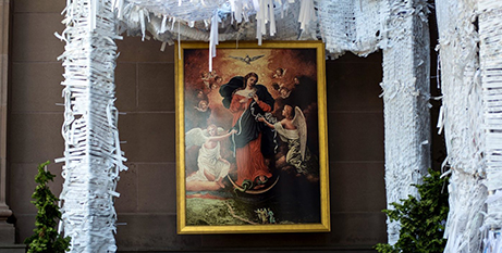 A painting of Mary, Undoer of Knots on display at St Peter's Basilica in 2015 (CNS/Carley Mossbrook)