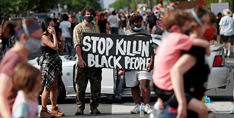 Protesters in Minneapolis gathered Wednesday at the place where George Floyd was killed on Monday (CNS/Eric Miller, Reuters)