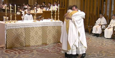 Frs Daniel and Stephen Drum embrace at their priestly ordination ceremony at St Mary's Cathedral in Sydney (Facebook/St Mary's Cathedral)