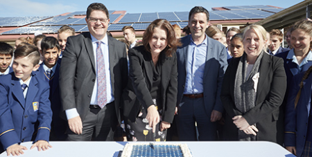 Cutting the solar cake to celebrate the energy efficiency rollout at Gilroy Catholic College, Castle Hill (Supplied)