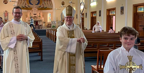 Bishop Ken Howell celebrated his third anniversary of episcopal ordination with Deacon Peter Pellicaan and altar server Angus Kangaroo Point on June 14 (The Catholic Leader)
