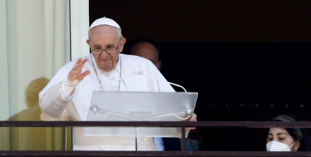 Pope Francis greets the crowd as he leads the Angelus from a balcony of Gemelli hospital in Rome yesterday. (CNS/Guglielmo Mangiapane, Reuters)