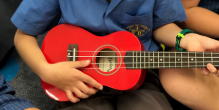 Students received gifts of donated musical instruments (Aurora)
