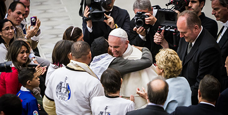 Pope Francis embraces a member of the group from Venezuela (DancingattheVatican.com)