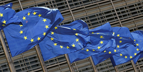 European Union flags outside EU headquarters in Brussels (CNS/Yves Herman, Reuters)
