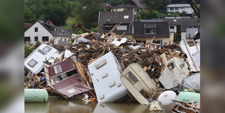 Debris  near flooded homes in Kreuzberg, Germany, on Monday (CNS/Wolfgang Rattay, Reuters)