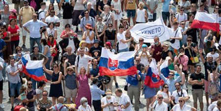 Pilgrims holding the Slovak flag cheer in St Peter's Square at the Vatican on July 4 as Pope Francis announces he will visit their country in September (CNS/Vatican Media)