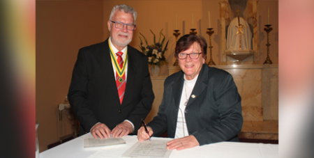 George Kazs and Sr Monica Cavanagh RSJ sign the patronage agreement on Monday (The Catenian Association)